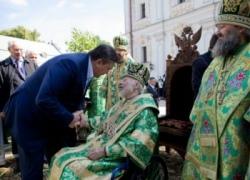 В Киеве Янукович и Литвин сходили к Митрополиту Владимиру